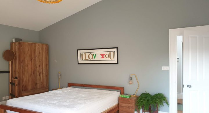 Green wall painted in bedroom