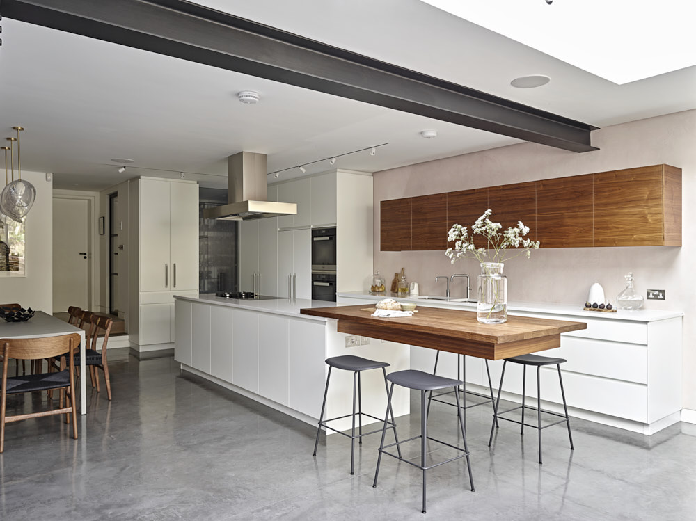 Charcoal grey steel beam exposed in white kitchen