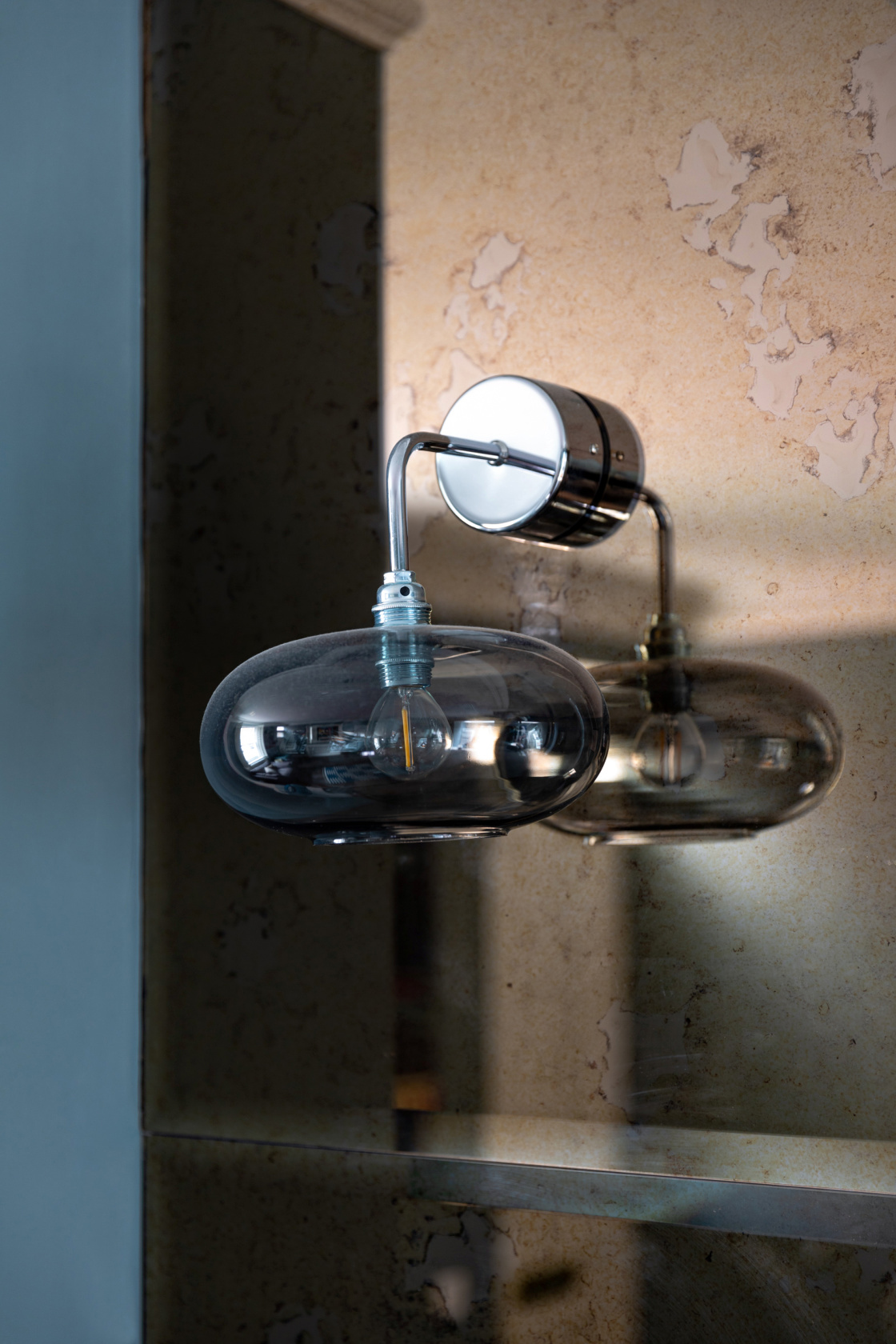 antiqued glass and contemporary wall light detail