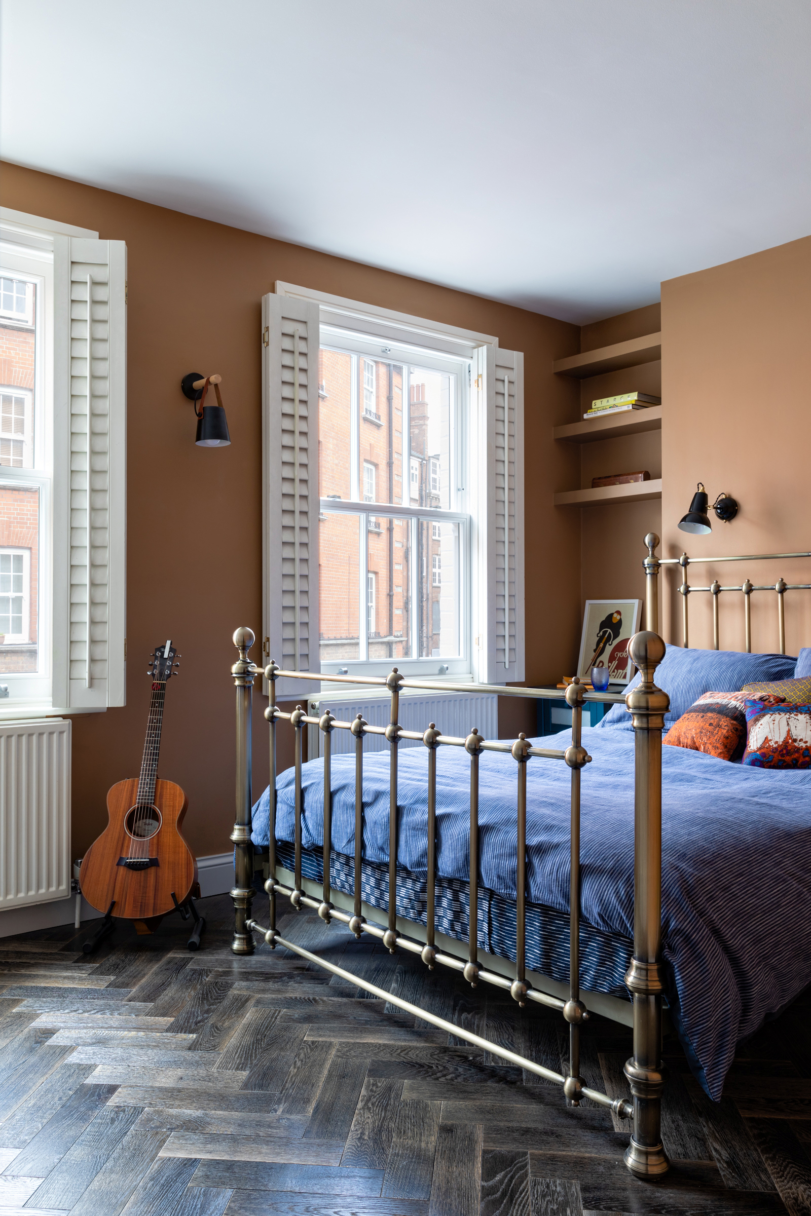 mustard coloured bedroom with blue