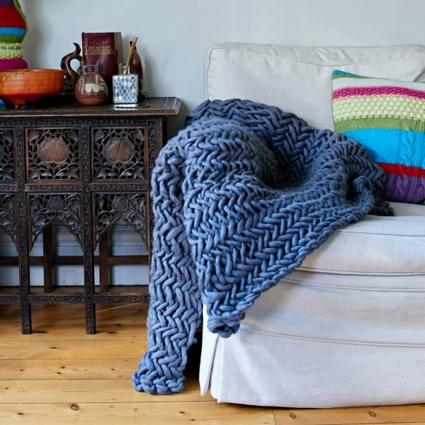 Alice Magnus Throw draped on sofa by Melanie Porter and available at The Decorcafe Shop