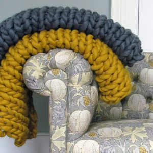 Loft Magnus Throw on armrest image by Melanie Porter available at The Decorcafe Shop