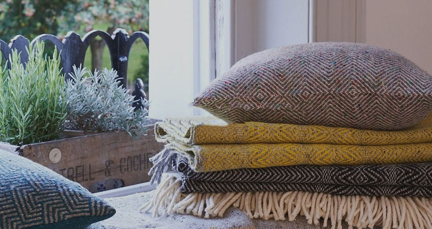 Craft Editions Collection Banner Lifestyle Image With Throws and Cushions Available at The Decorcafe