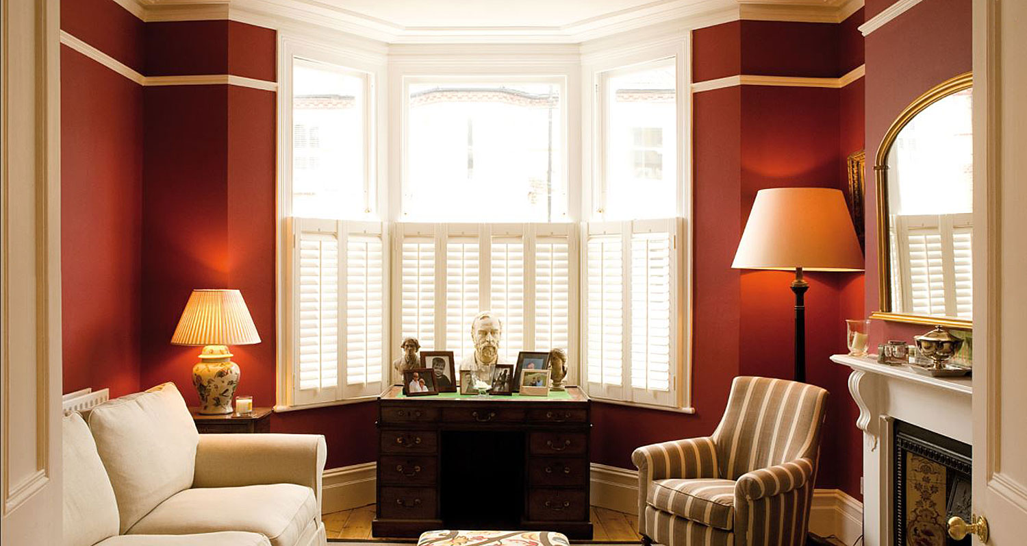 Paint the Town Green Eco Paint in Ruby available at The Decorcafe, lifestyle image showing the paint in situ in a living room