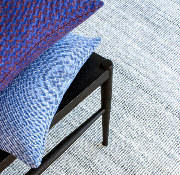 Blue Linen Cushions with chevron pattern lifestyle image by Claire Gaudion at The Decorcafe